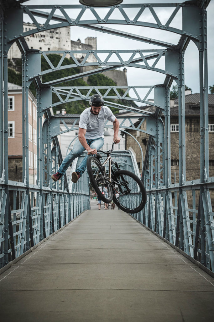 leafcycles team rider simon edfelder throwing a tail whip